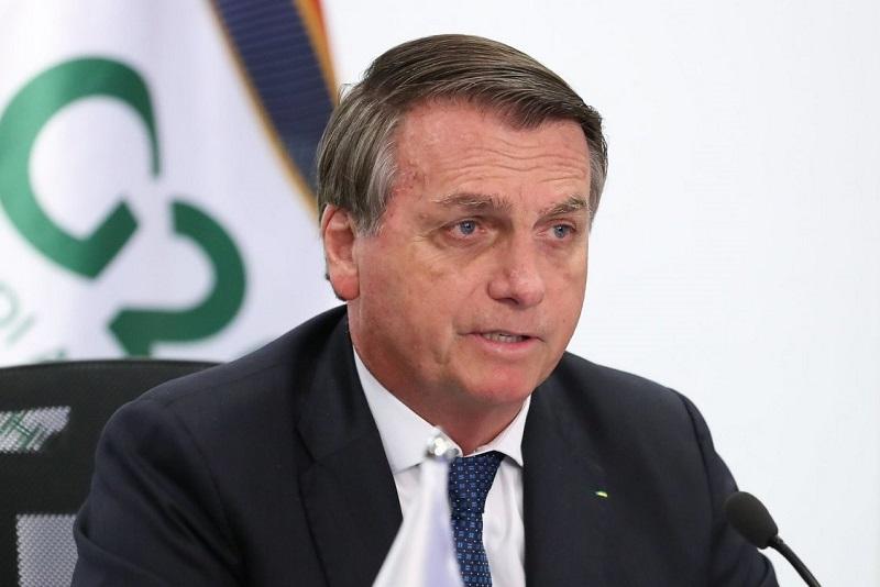 Bolsonaro diz que alta da Covid-19 é repique e que não é preciso pressa por vacina